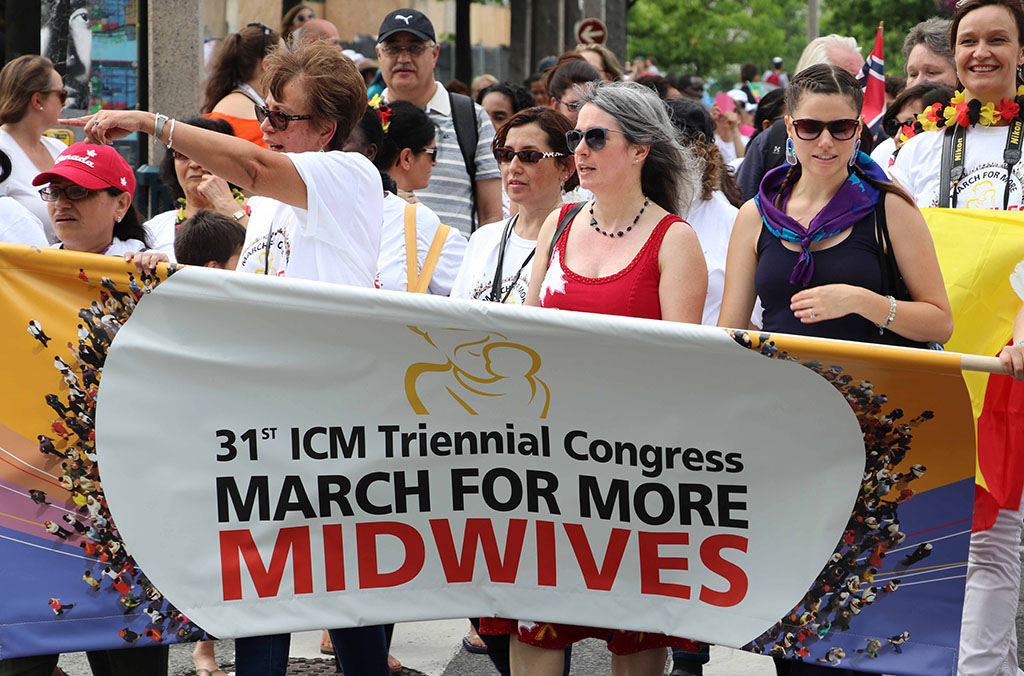 CAM president Katrina Kilroy leads the March for More Midwives, Toronto ON